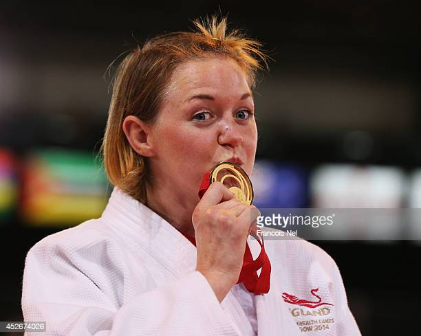 Gold medalist Megan Fletcher of England poses on the podium during the medal ceremony for the Women's 70kg Judo at SECC Precinct during day two of...