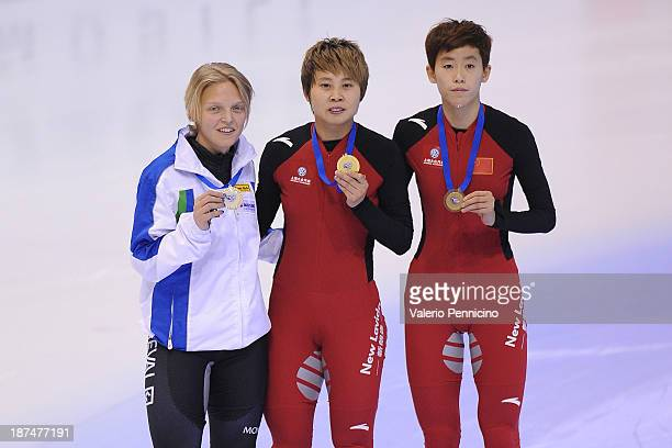 Gold medalist Meng Wang of China Silver medalist Arianna Fontana of Italy and bronze medalist Kexin Fan of China pose during the medal presentation...