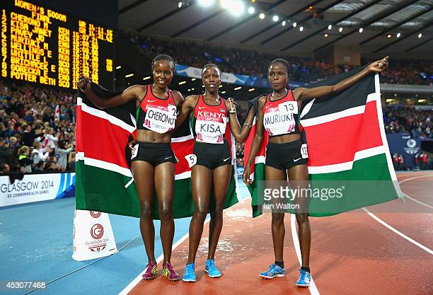 Gold medalist Mercy Cherono of Kenya silver medalist Janet Kisa of Kenya and Margaret Muriuki of Kenya pose after the Women's 5000 metres final at...