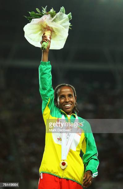 Gold medalist Meseret Defar of Ethiopia celebrates her medal during the Victory Ceremony for the Women's 5000m on day eight of the 11th IAAF World...