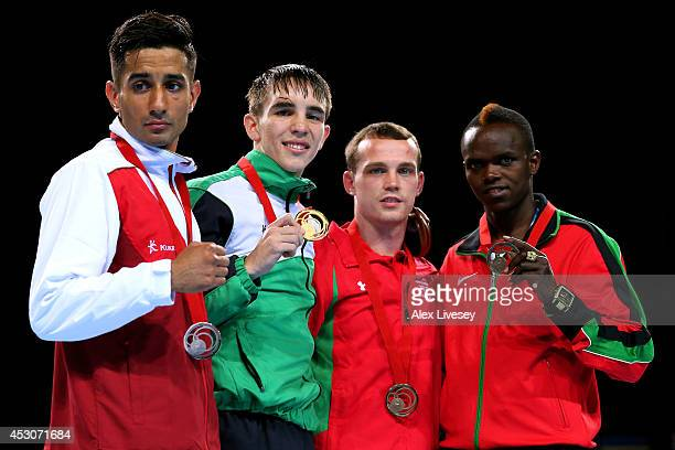 Gold medalist Michael Conlan of Northern Ireland poses with silver medalist Qais Ashfaq of England and bronze medalists Sean Mcgoldrick of Wales and...