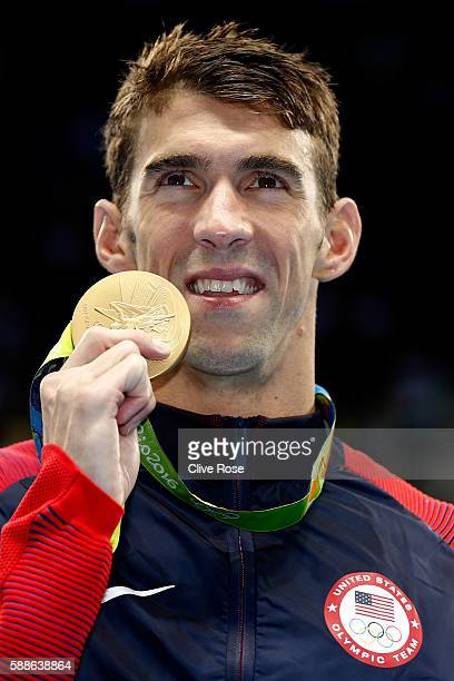 Gold medalist Michael Phelps of the United States poses during the medal ceremony for the Men's 200m Individual Medley Final on Day 6 of the Rio 2016...