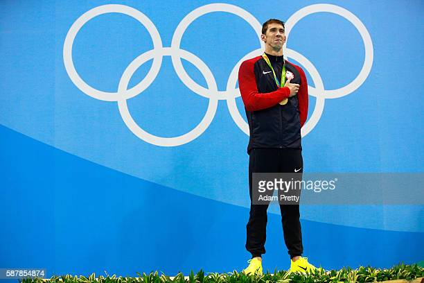 Gold medalist Michael Phelps of the United States poses on the podium during the medal ceremony for the Men's 200m Butterfly Final on Day 4 of the...