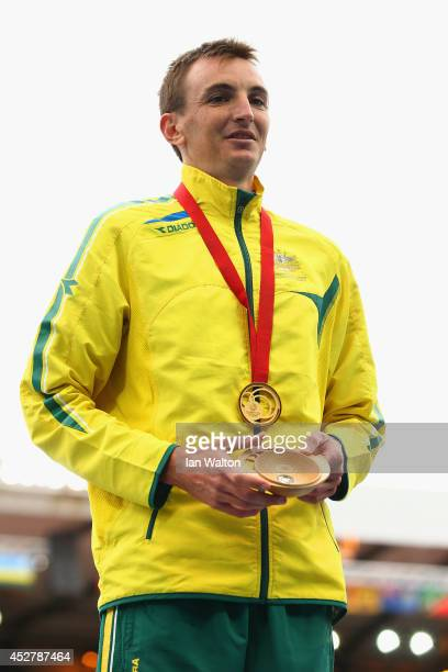 Gold medalist Michael Shelley of Australia stands on the podium during the medal ceremony for the Men's Marathon at Hampden Park Stadium during day...