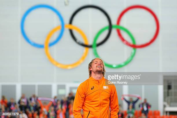 Gold medalist Michel Mulder of the Netherlands celebrates on the podium during the flower ceremony for the Men's 500m Speed Skating eventduring day 3...
