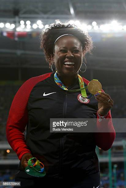 Gold medalist Michelle Carter of the United States celebrates on the podium during the medal ceremony for the Women's Shot Put on Day 8 of the Rio...