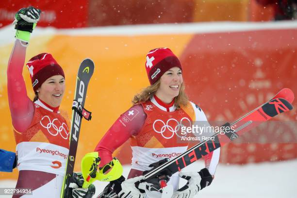 Gold medalist Michelle Gisin of Switzerland and bronze medalist Wendy Holdener of Switzerland celebrate at the finish during the Ladies' Alpine...