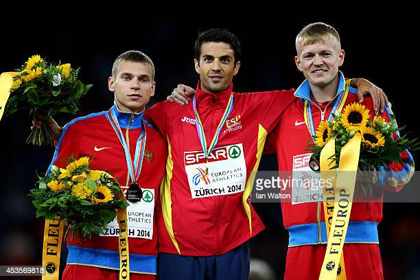 Gold medalist Miguel Angel Lopez of Spain poses next to silver medalist Aleksandr Ivanov of Russia and bronze medalist Denis Strelkov of Russia...