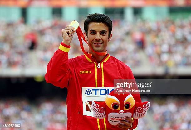 Gold medalist Miguel Angel Lopez of Spain poses on the podium during the medal ceremony for the Men's 20km Race Walk during day two of the 15th IAAF...