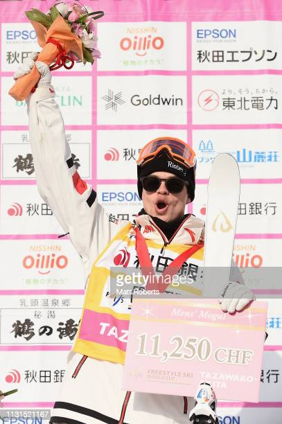 Gold medalist Mikael Kingsbury of Canada celebrates during the medal ceremony on day one of the Men's FIS Freestyle Skiing World Cup Tazawako on...
