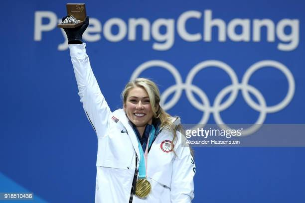 Gold medalist Mikaela Shiffrin of the United States celebrates during the medal ceremony for Alpine Skiing - Ladies' Giant Slalom on day six of the...