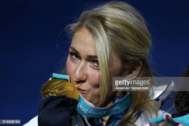 Gold medalist Mikaela Shiffrin of the United States kisses her medal during the medal ceremony for Alpine Skiing Ladies' Giant Slalom on day six of...