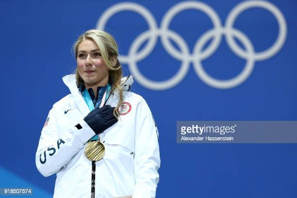 Gold medalist Mikaela Shiffrin of the United States listens to the national anthem during the medal ceremony for Alpine Skiing Ladies' Giant Slalom...