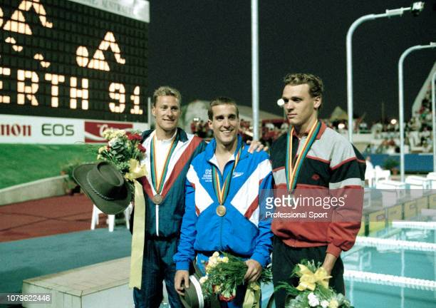 Gold medalist Mike Barrowman of the United States poses alongside silver medalist Norbert Rozsa of Hungary and bronze medalist Nick Gillingham of...