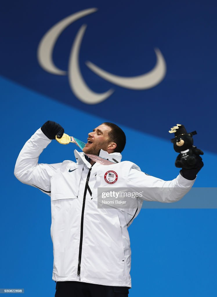 Gold medalist Mike Schultz of United States celebrates during the medal ceremony for the Men's Snowboard Cross SB-LL1 during day three of the PyeongChang 2018 Paralympic Games on March 12, 2018 in Pyeongchang-gun, South Korea.