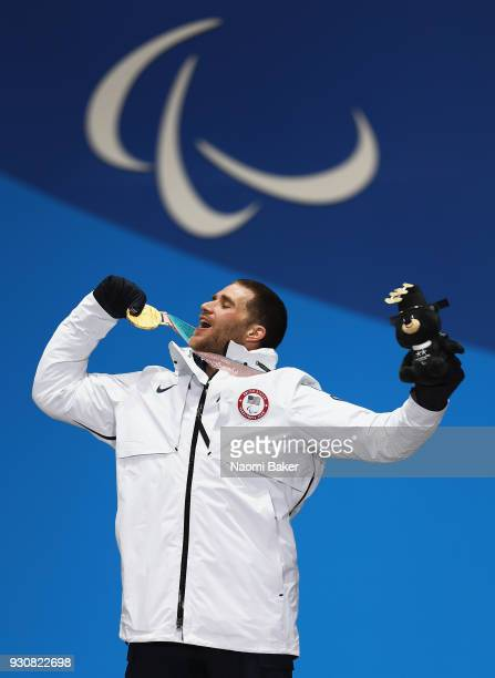 Gold medalist Mike Schultz of United States celebrates during the medal ceremony for the Men's Snowboard Cross SBLL1 during day three of the...