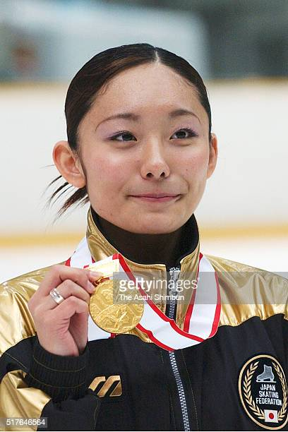 Gold medalist Miki Ando celebrates on the podium at the medal ceremony for the Women's Singles during day two of the 72nd All Japan Figure Skating...