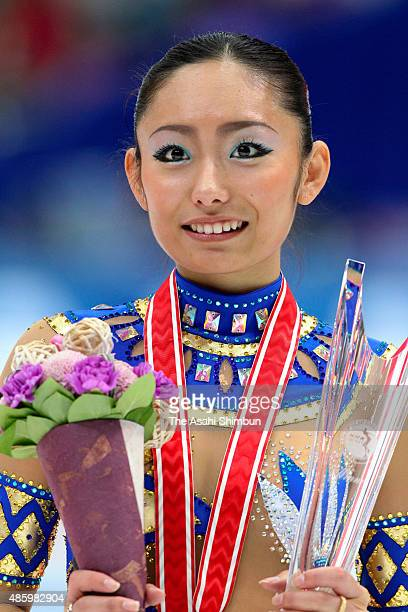 Gold medalist Miki Ando of Japan celebrates on the podium at the medal ceremony for the the Ladies Singles during day two of the ISU Figure Skating...
