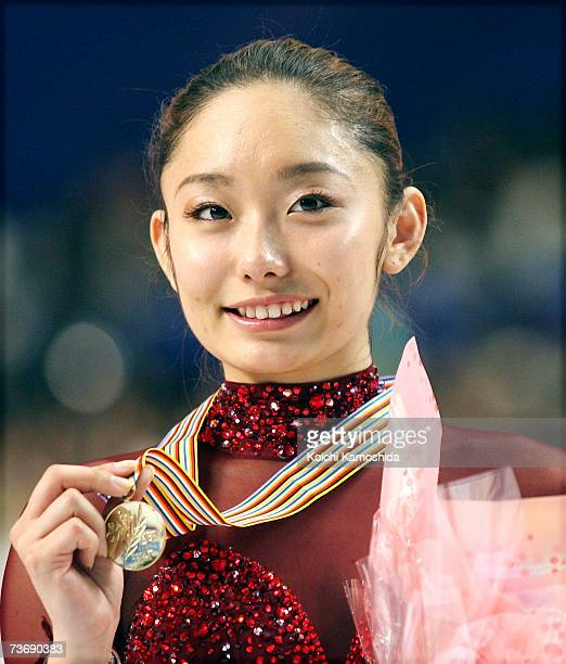 Gold medalist Miki Ando of Japan poses for photographers after the medals ceremony during the women's Free Skating program at the World Figure...