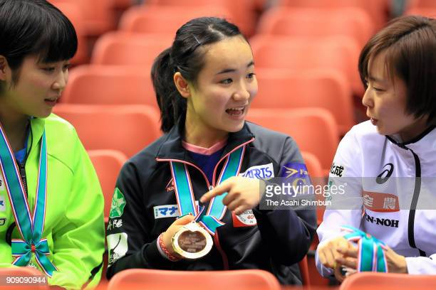 Gold medalist Mima Ito talks with silver medalist Miu Hirano and bronze medalist Kasumi Ishikawa after the Women's Singles medal ceremony day seven...