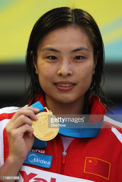 Gold medalist Minxia Wu of China attends the victory ceremony for the Women's 3m Springboard Final during Day Eight of the 14th FINA World...