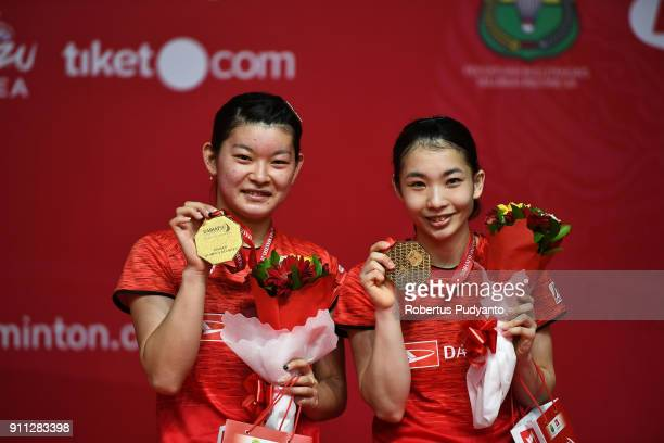 Gold medalist Misaki Matsutomo and Ayaka Takahashi of Japan celebrate on the podium during the Women's Doubles awarding ceremony of the Daihatsu...