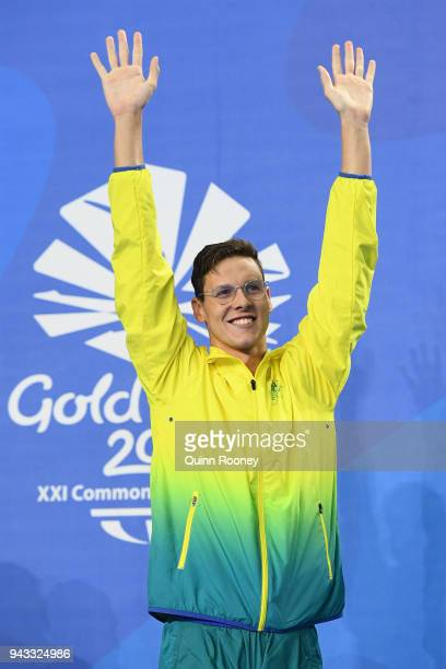 Gold medalist Mitch Larkin of Australia poses during the medal ceremony for the Men's 50m Backstroke Final on day four of the Gold Coast 2018...