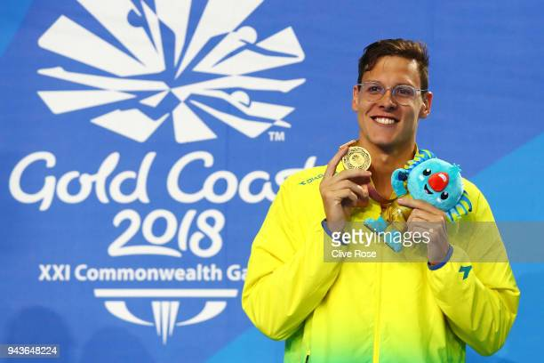 Gold medalist Mitch Larkin of Australia poses during the medal ceremony for the Men's 200m Backstroke Final on day five of the Gold Coast 2018...