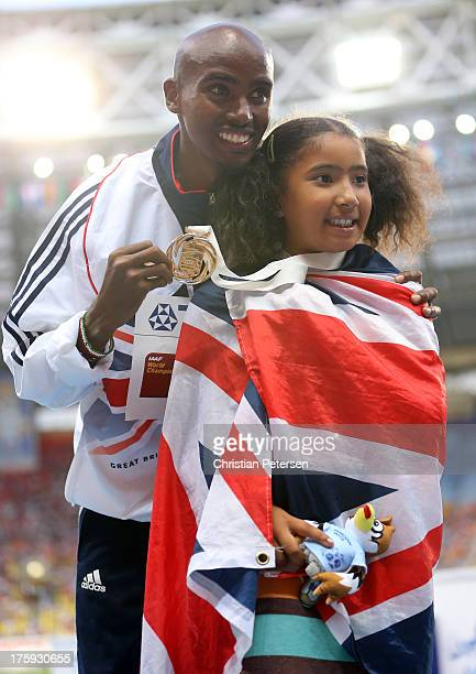 Gold medalist Mo Farah of Great Britain on the podium with daughter Rhianna Farah during the medal ceremony for the Men's 10000 metresduring Day One...