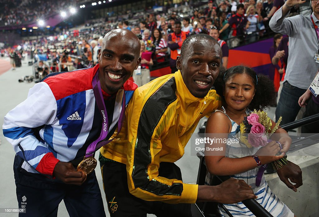Gold medalist Mohamed Farah of Great Britain and his daughter Rihanna Farah pose with Gold medalist Usain Bolt of Jamaica on Day 15 of the London 2012 Olympic Games at Olympic Stadium on August 11, 2012 in London, England.