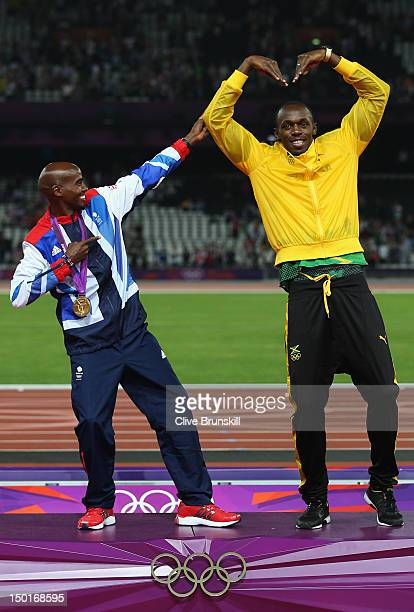 Gold medalist Mohamed Farah of Great Britain and Usain Bolt of Jamaica pose on the podium on Day 15 of the London 2012 Olympic Games at Olympic...