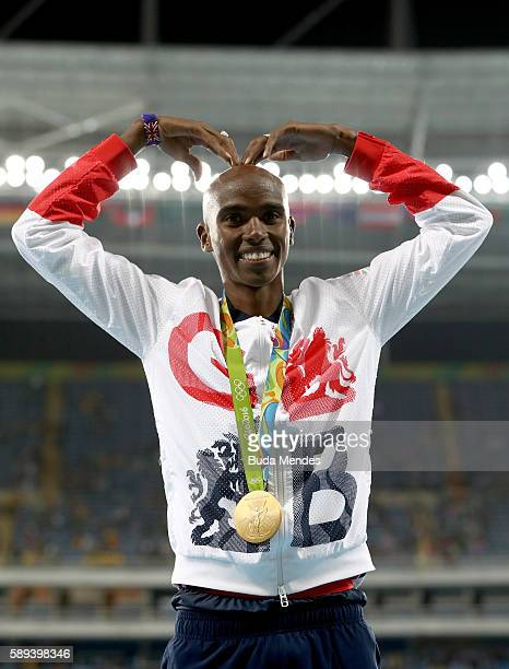 Gold medalist Mohamed Farah of Great Britain celebrates on the podium during the medal ceremony for the Men's 10,000m on Day 8 of the Rio 2016...