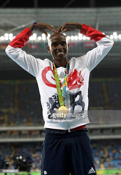 Gold medalist Mohamed Farah of Great Britain celebrates on the podium during the medal ceremony for the Men's 10000m on Day 8 of the Rio 2016 Olympic...