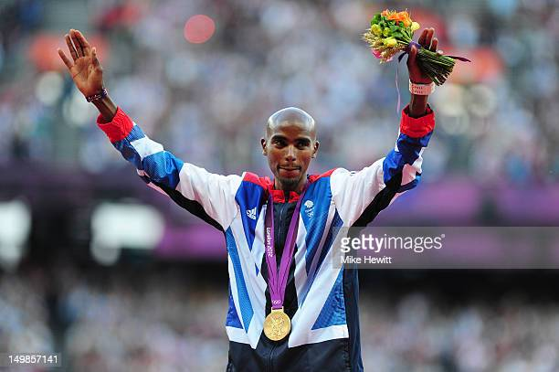 Gold medalist Mohamed Farah of Great Britain poses on the podium for Men's 10,000m on Day 9 of the London 2012 Olympic Games at the Olympic Stadium...