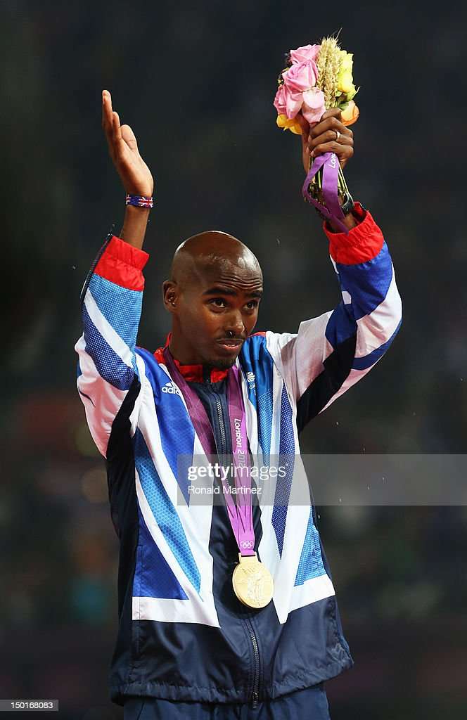 Gold medalist Mohamed Farah of Great Britain poses on the podium during the medal ceremony for the Men's 5000m on Day 15 of the London 2012 Olympic Games at Olympic Stadium on August 11, 2012 in London, England.