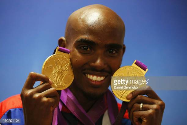 Gold medalist Mohamed Farah of Great Britain poses with his medals for the 10000m and 5000m as he attends a TEAM GB Press Conference during Day 16 of...