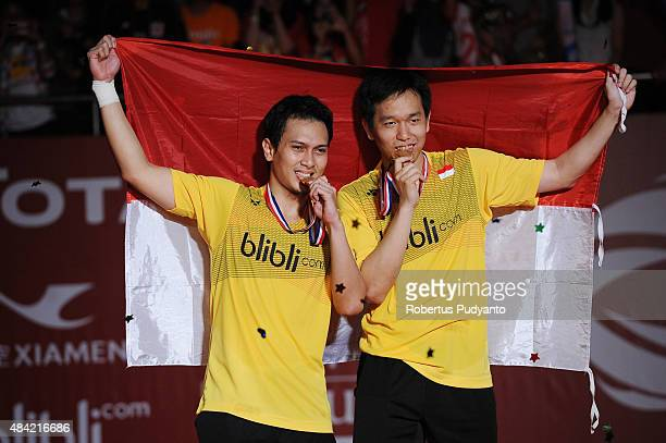 Gold medalist Mohammad Ahsan and Hendra Setiawan of Indonesia celebrate on the podium in the men doubles awarding ceremony of the 2015 Total BWF...