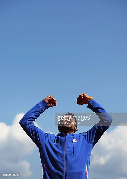 Gold medalist, Mohsen Shadinaghadeh of Iran celebrates following the Men's Single Sculls Final during day six of the 2014 Asian Games at the Chungju...