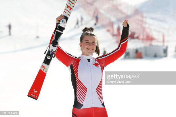 Gold medalist Mollie Jepsen of Canada celebrates at the victory ceremony in the Alpine Skiing Women's Super Combined Standing during day four of the...