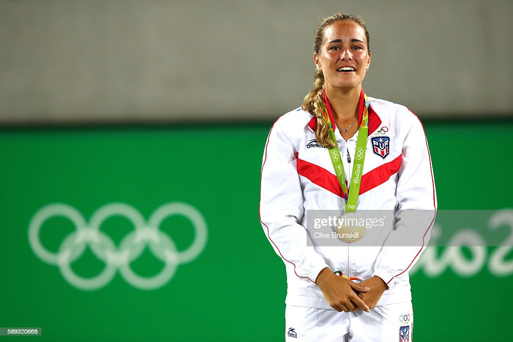 Gold medalist Monica Puig of Puerto Rico poses during the medal ceremony for Women's Singles on Day 8 of the Rio 2016 Olympic Games at the Olympic Tennis Centre on August 13, 2016 in Rio de Janeiro, Brazil.