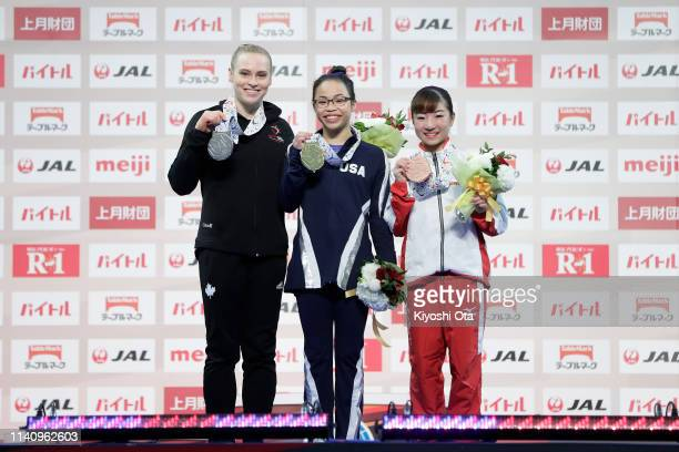 Gold medalist Morgan Hurd of the United States celebrates with silver medalist Ellie Black of Canada and bronze medalist Asuka Teramoto of Japan at...
