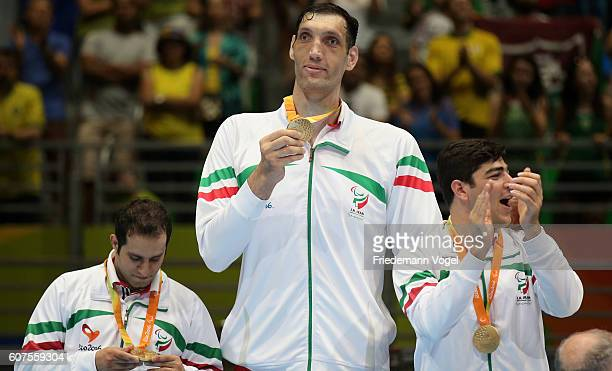 Gold medalist Morteza Mehrzadselakjani of Iran poses on the podium at the medal ceremony after the Sitting Volleyball match between Bosnia and...