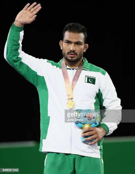 Gold medalist Muhammad Inam of Pakistan poses during the medal ceremony for the men's Freestyle 86kg match during Wrestling on day 10 of the Gold...