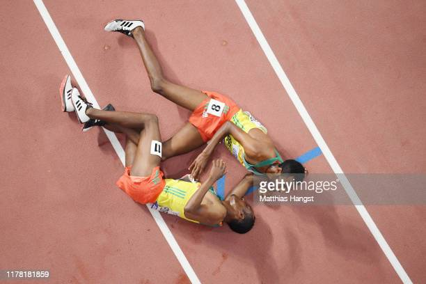 Gold medalist Muktar Edris of Ethiopia and Telahun Haile Bekele of Ethiopia celebrate after the Men's 5000 metres final during day four of 17th IAAF...