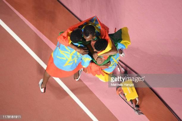 Gold medalist Muktar Edris of Ethiopia, silver medalist Selemon Barega of Ethiopia and Telahun Haile Bekele of Ethiopia celebrate after the Men's...