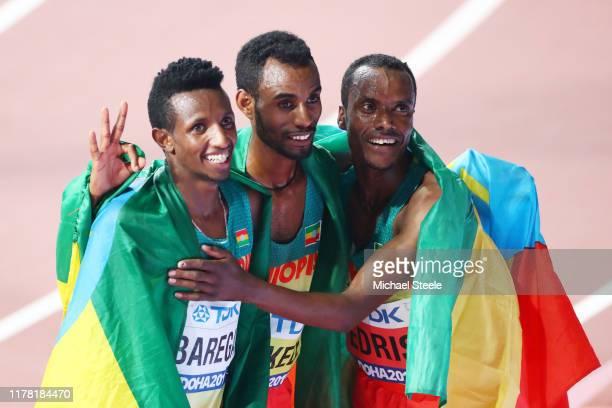 Gold medalist Muktar Edris of Ethiopia , silver medalist Selemon Barega of Ethiopia and Telahun Haile Bekele of Ethiopia celebrate after the Men's...
