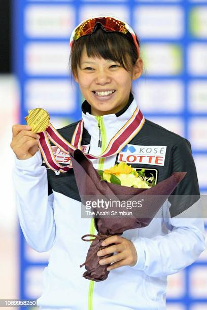 Gold medalist Nana Takagi of Japan celebrates on the podium at the medal ceremony for the Women's Mass Start on day two of the ISU World Cup Speed...