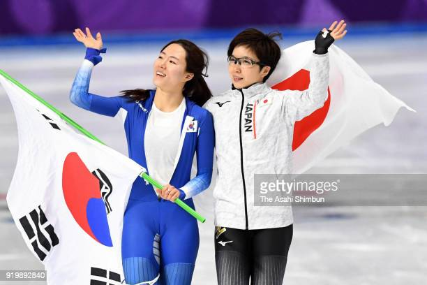 Gold medalist Nao Kodaira of Japan and silver medalist Lee Sanghwa of South Korea embrace after the Ladies' 500m Individual Speed Skating Final on...