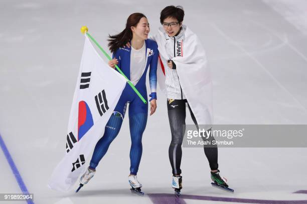 Gold medalist Nao Kodaira of Japan and silver medalist Lee Sang-hwa of South Korea embrace after the Ladies' 500m Individual Speed Skating Final on...