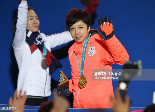 Gold medalist Nao Kodaira of Japan and silver medalist Lee Sanghwa of South Korea celebrate during the medal ceremony for Speed Skating Ladies' 500m...